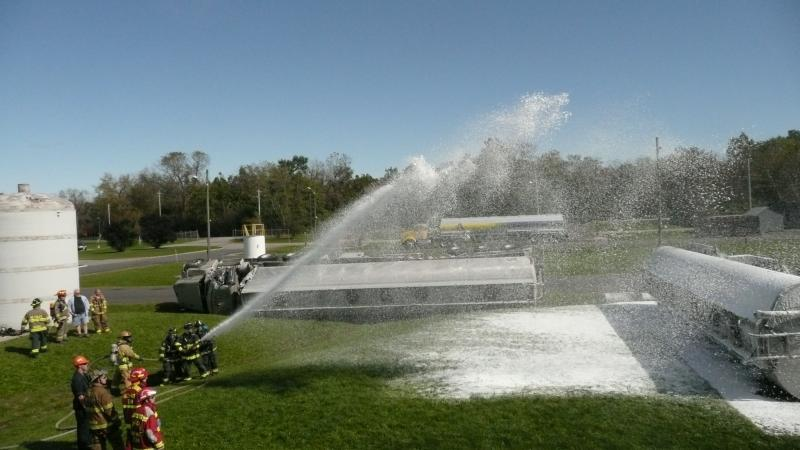 Firefighters use foam to contain chemical fires